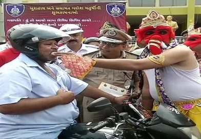 Do you wear helmet while on two wheeler? Lord Ganesha will offer you a 'laddoo' then!